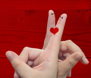 Conceptual love fingers on red wood